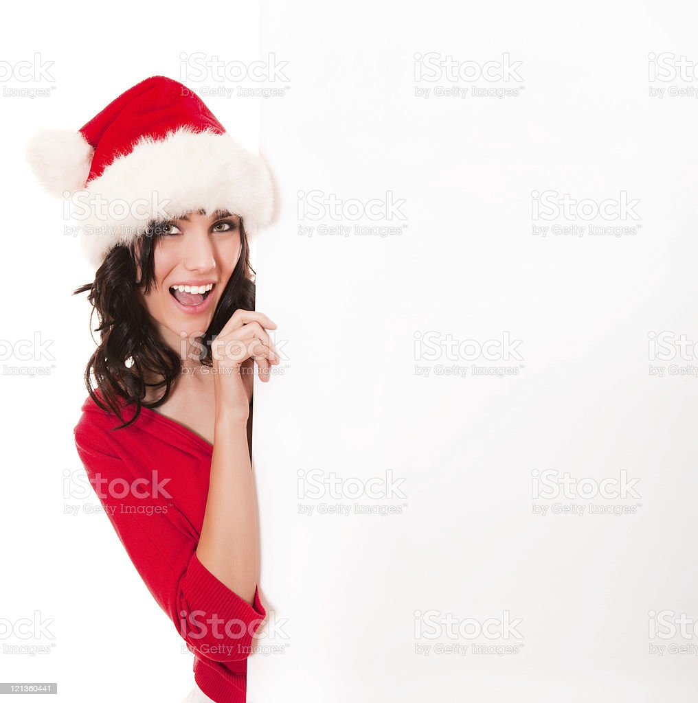 Christmas girl holding a blank card royalty-free stock photo