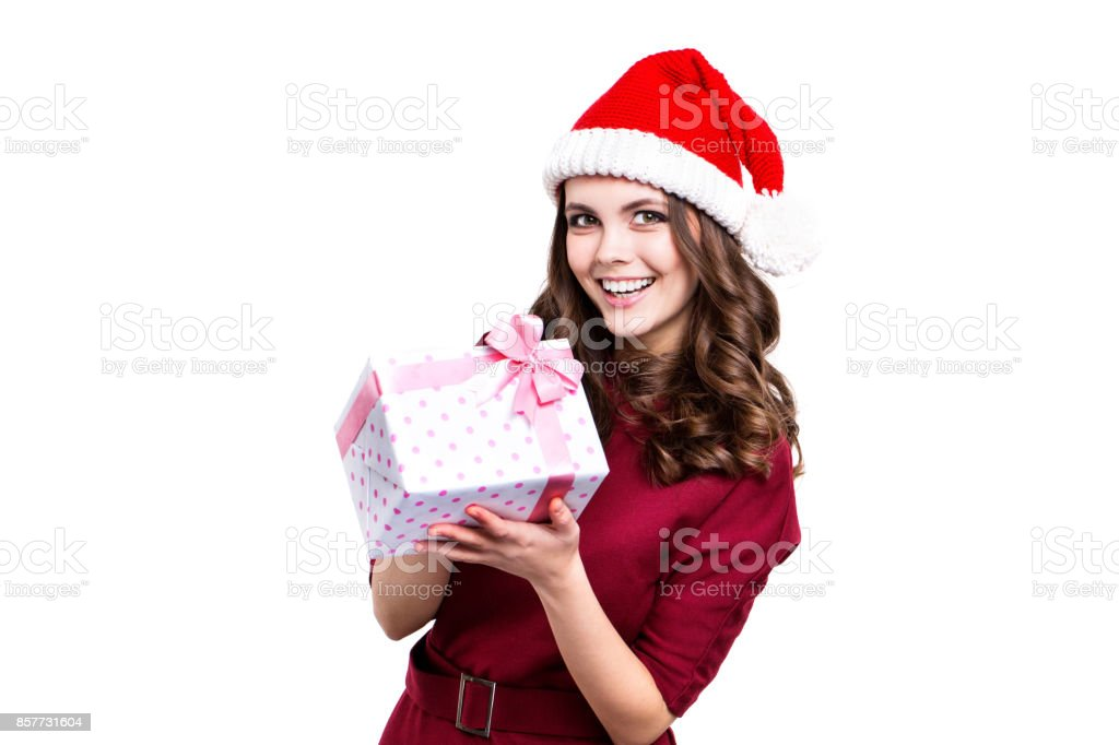 a41ad0b305120 Christmas Girl In A Santa Hat Holds A Gift Box Stock Photo   More ...