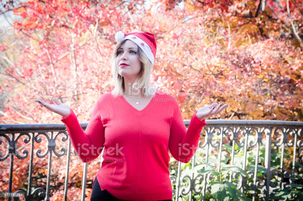 Christmas girl with hands up in the air stock photo