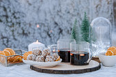 Glögg Mulled wine outdoors in frosty greenhouse Cozy christmas winter still life with warm mulled wine glögg and raw balls Photo taken with natural light