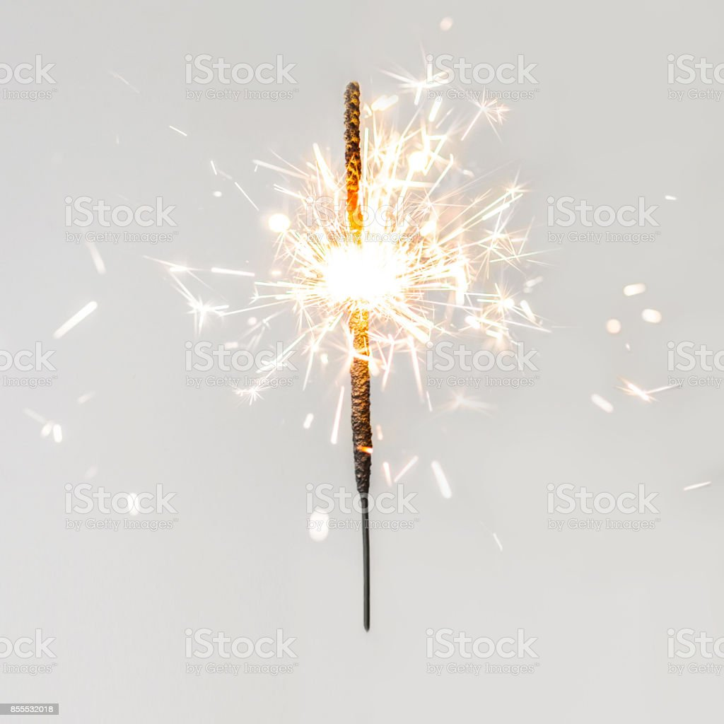 Christmas glittering  sparklers. decoration lighting element. Festive  Magic sparks lights for holiday poster, birthday or party concept. Xmas decoration lighting element.'n stock photo