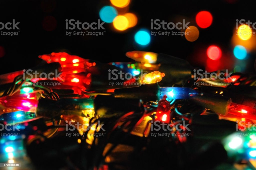 Christmas glowing electric garland with lights on a bokeh stock photo