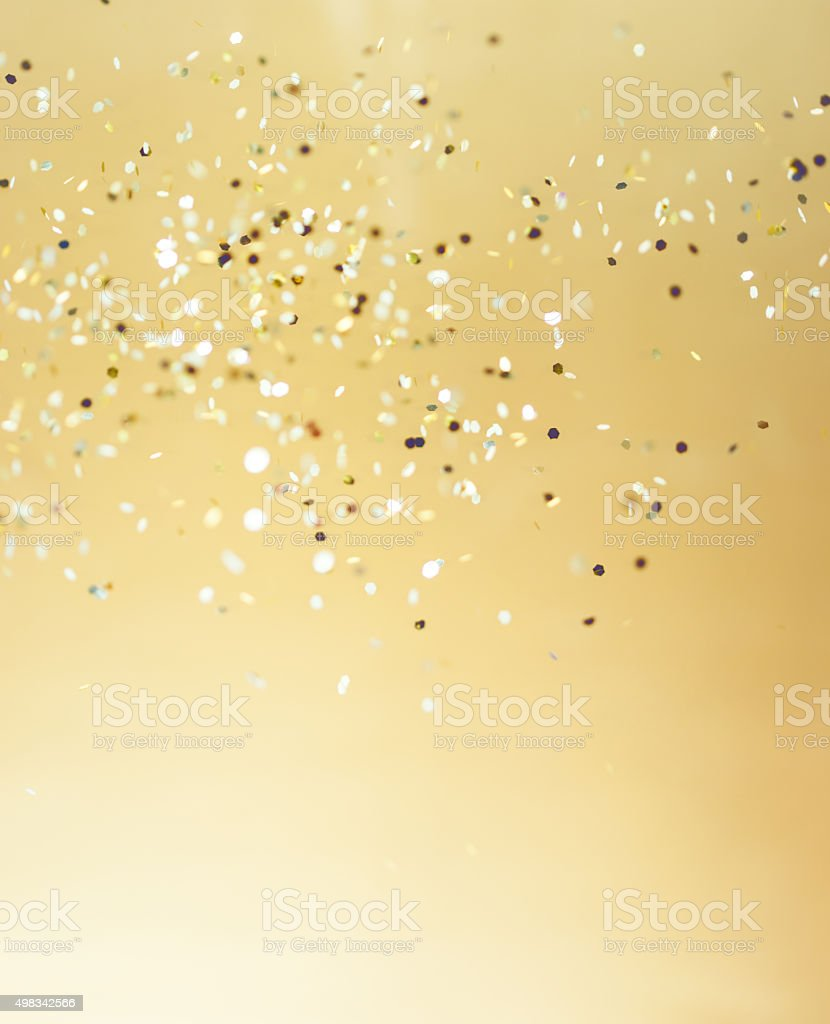 Christmas gold background. Golden holiday glowing abstract glitt stock photo