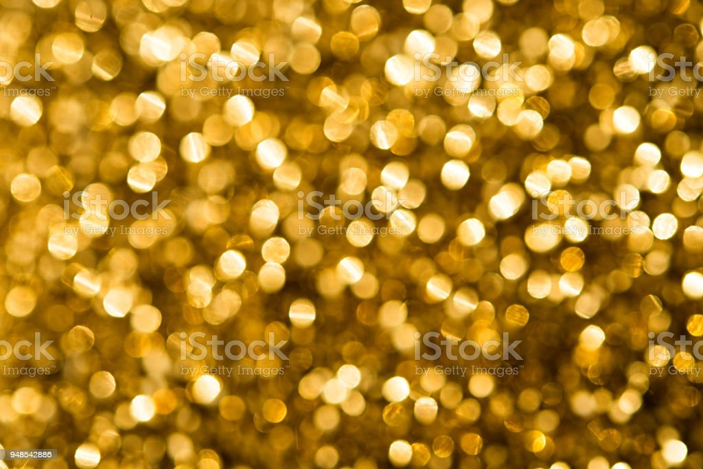 Christmas gold background with circles in bokeh
