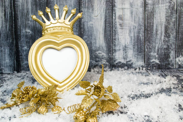 Christmas gold crown frame on gray wooden background stock photo