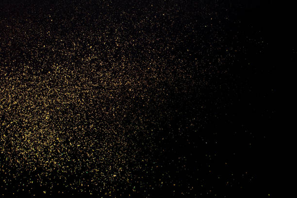 Christmas Gold glitter on black background. Holiday abstract texture stock photo