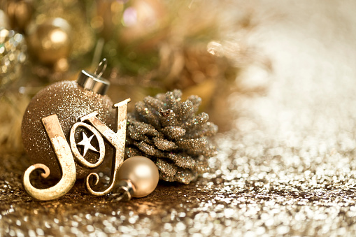 Christmas Gold Ornaments Background. Very shallow depth.