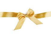 istock Christmas gold ribbon with bow isolated on white 1184702207