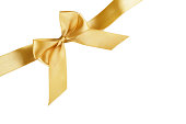 istock Christmas gold ribbon with bow isolated on white 1184703153