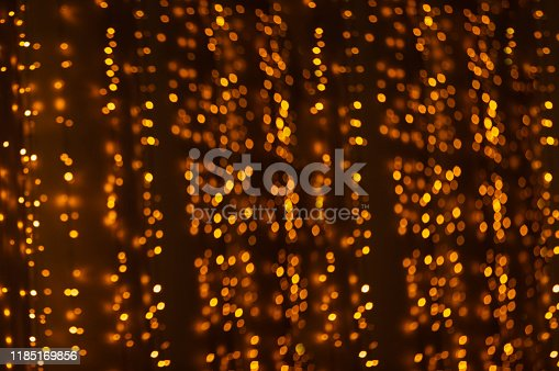 846933050 istock photo Christmas golden bokeh. Bright holiday lights 1185169856