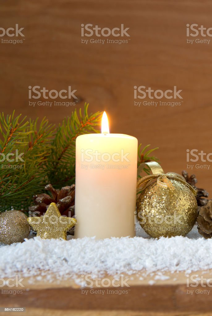 Christmas golden decoration and Advent candle royalty-free stock photo