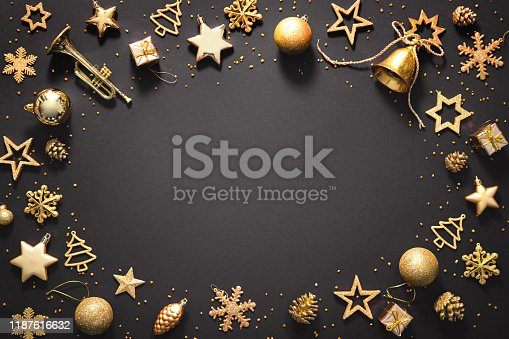 Christmas golden decoration on dark background. Template for greeting card