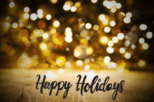 christmas golden lights background, calligraphy happy holidays - happy holidays stock pictures, royalty-free photos & images