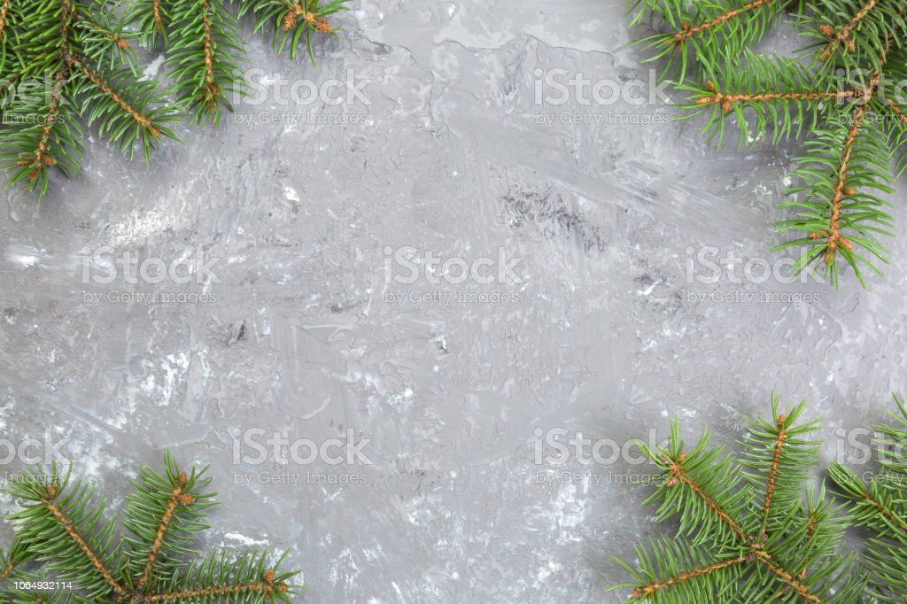 Christmas Gray Cement Background With Fir Tree And Copy Space Top