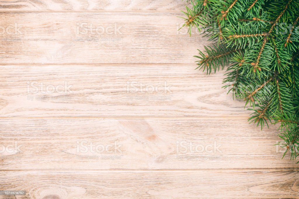 Christmas Gray Wooden Background With Fir Tree And Copy Space