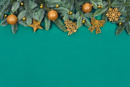 istock Christmas green background with golden toys. 1190445270