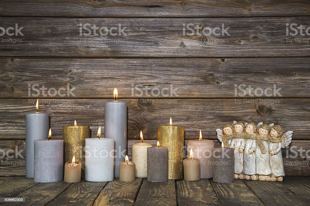 Christmas greeting card with candles and angels. stock photo