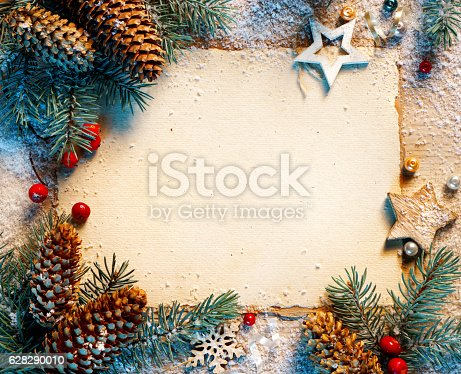 istock Christmas greeting card with fir branches 628290010