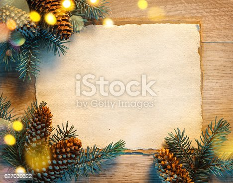 istock Christmas greeting card with fir tree 627030322