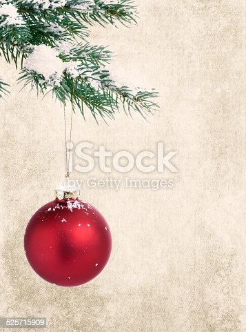 Christmas holiday grunge rustic red ornament bauble and pine branch tree background