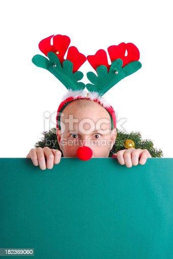 istock Christmas Guy Peeking over Sign 182369060
