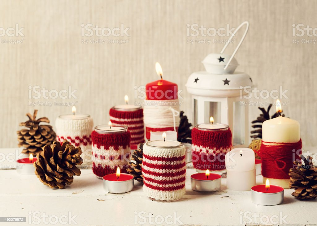 christmas handmade christmas candles in the candle holders knit royalty free stock photo