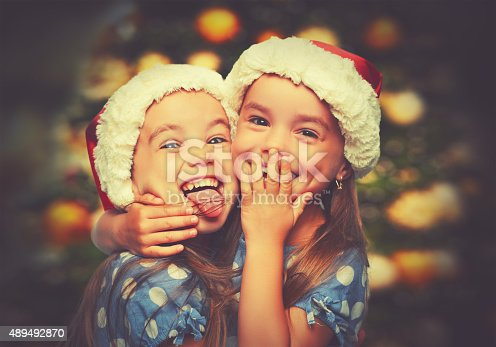 istock Christmas Happy funny children twins sisters 489492870