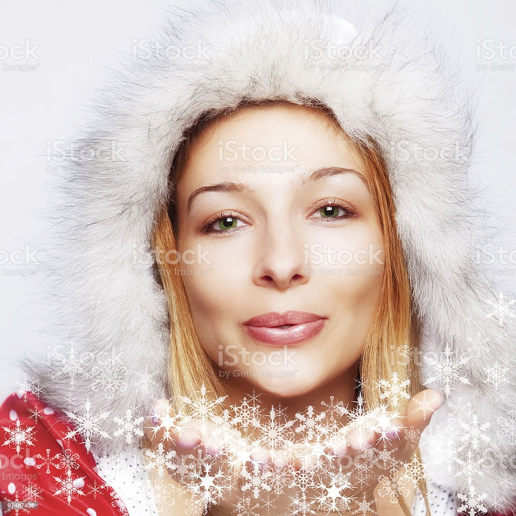Christmas - happy woman blowing snow flakes royalty-free stock photo