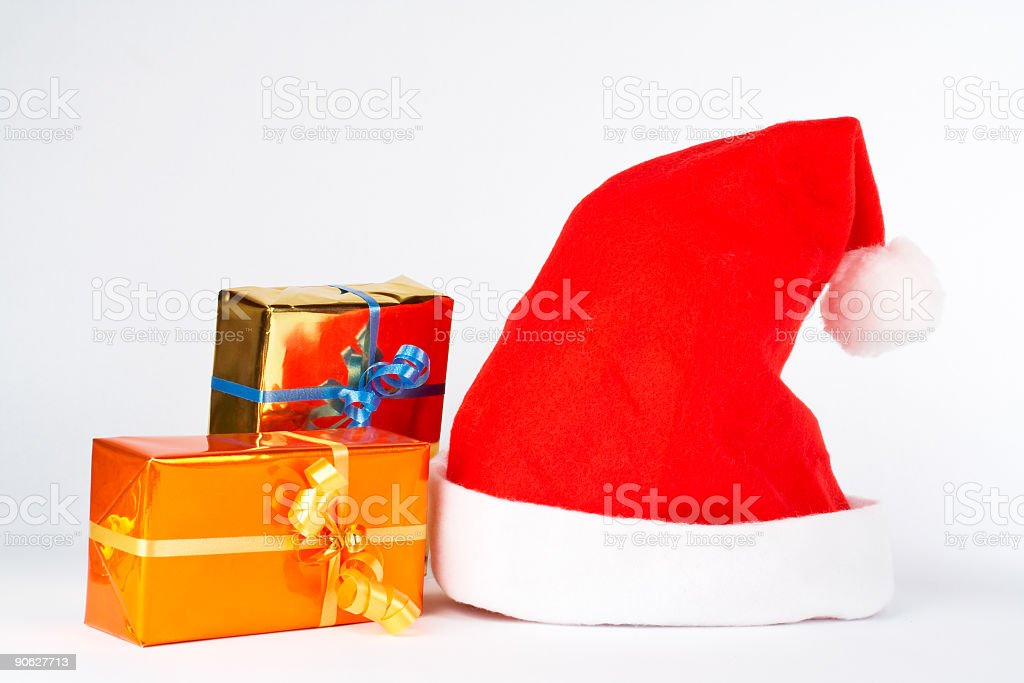Christmas hat and two gifts royalty-free stock photo