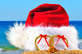 istock Christmas hat with hearts against blue sky 527612411