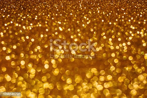 istock Christmas holiday abstract bokeh background with gold lights. Glitter golden bokeh background 1096545702