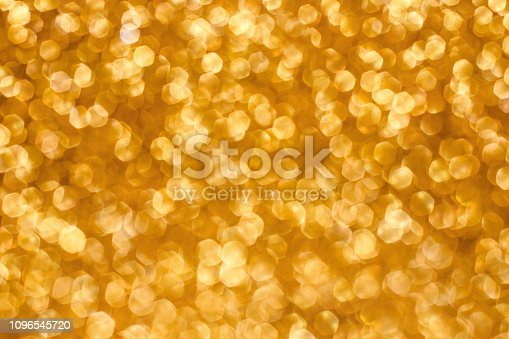 istock Christmas holiday abstract bokeh background with gold lights. Glitter golden bokeh background 1096545720