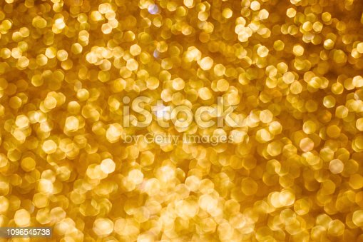 istock Christmas holiday abstract bokeh background with gold lights. Glitter golden bokeh background 1096545738