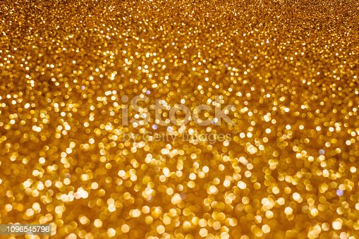 istock Christmas holiday abstract bokeh background with gold lights. Glitter golden bokeh background 1096545796