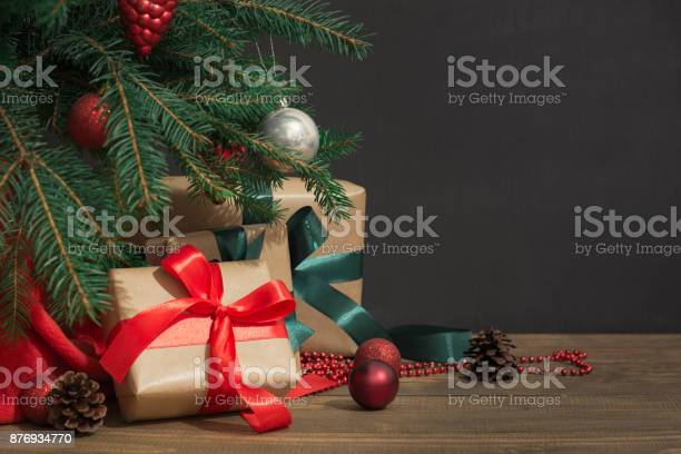 Christmas holiday background gifts with a red ribbon santas hat and picture id876934770?b=1&k=6&m=876934770&s=612x612&h=dmkikjf9vbvvb1fshy4vfmctblx49u6mgitnu8ts ku=
