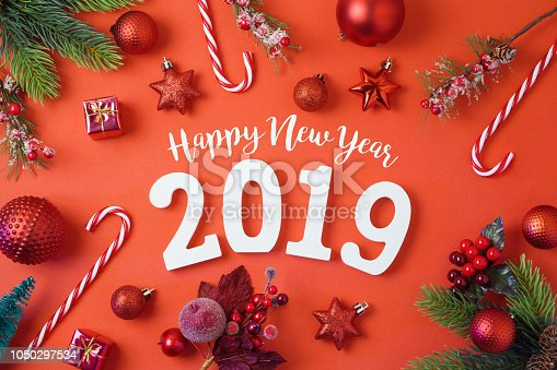 istock Christmas holiday background with 2019 new year, decorations and ornaments on red table 1050297534