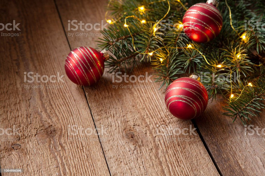 Christmas holiday background with branches of fir-tree and red...