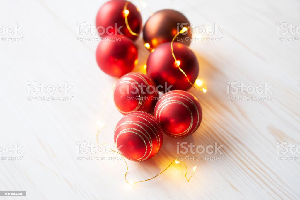 Christmas holiday background with red Christmas balls and garland on...