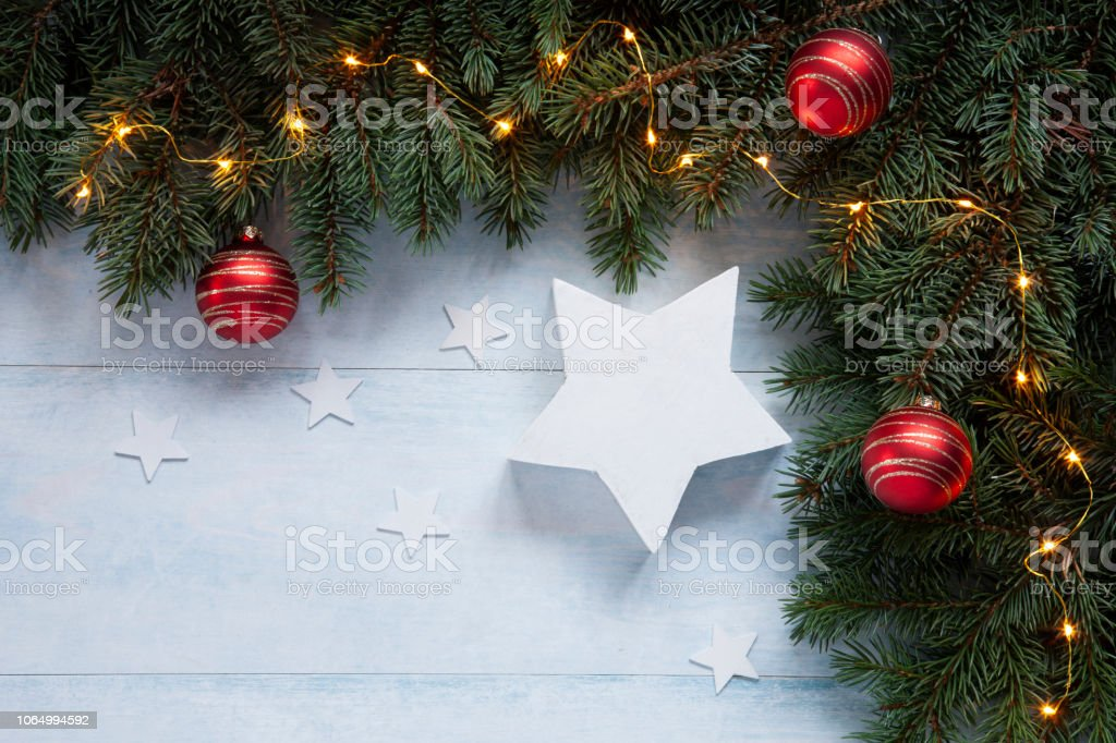 Christmas holiday background with white Christmas stars, red balls...