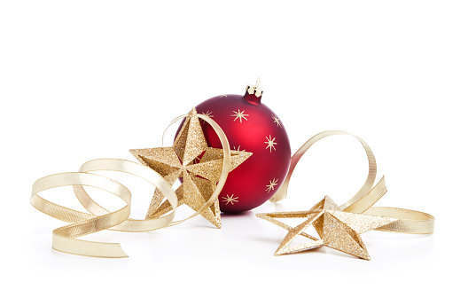 Christmas holiday bauble with gold star decorations and ribbon isolated on white