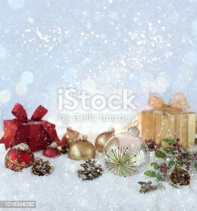 1020742072istockphoto Christmas holiday baubles and gifts with festive and sparkling lights 1016346282