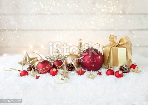 istock Christmas holiday baubles and gifts with festive and sparkling lights 1020742072