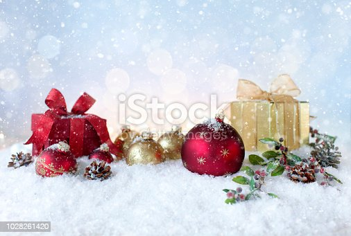 1020742072istockphoto Christmas holiday baubles and gifts with festive and sparkling lights 1028261420