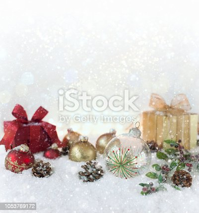 1020742072istockphoto Christmas holiday baubles and gifts with festive and sparkling lights 1053769172