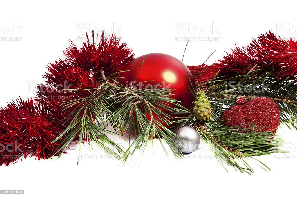 Christmas holiday composition with red ball and tinsel royalty-free stock photo