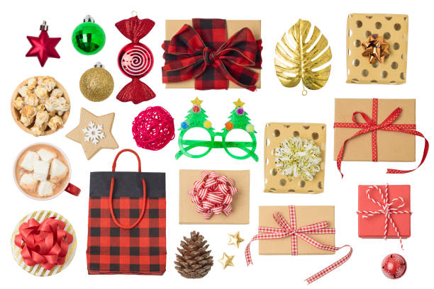Christmas holiday concept with gift boxes, chocolate cup, ornaments and decorations isolated on white background. stock photo
