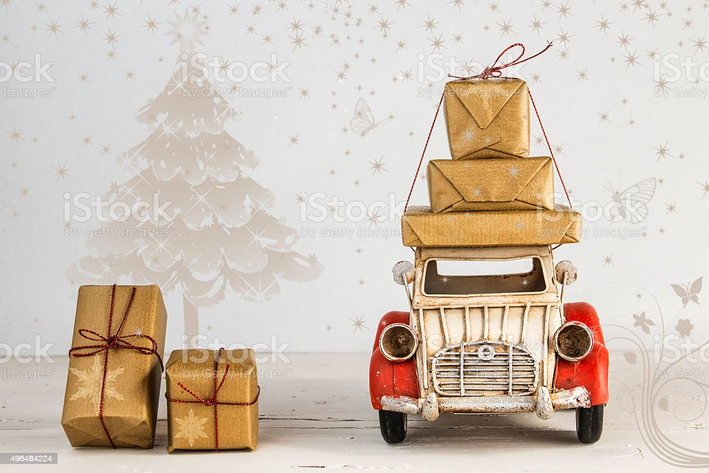 Christmas holiday concept with gift boxes on toy car stock photo