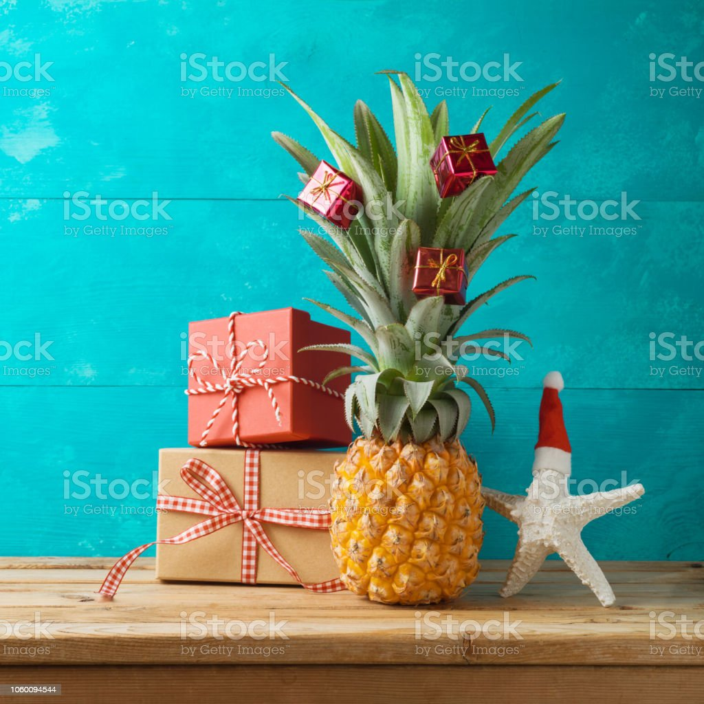 Christmas Pineapple.Christmas Holiday Concept With Pineapple As Alternative Christmas Tree And Gift Boxes On Wooden Table With Copy Space Stock Photo Download Image Now
