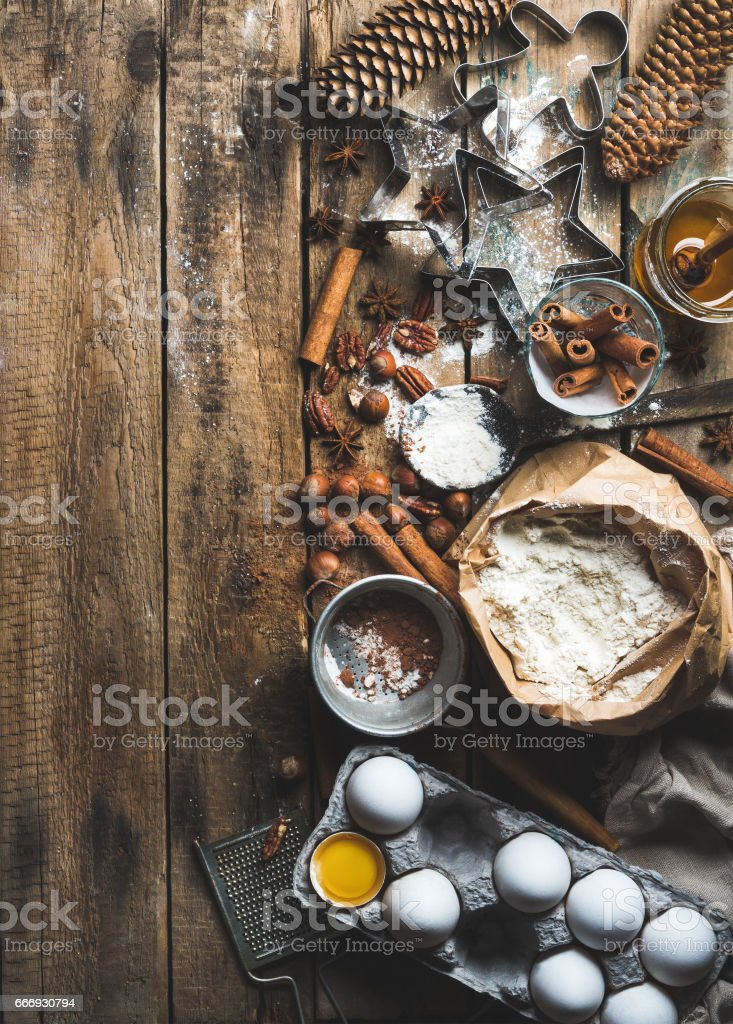 Christmas holiday cooking and baking ingredients on rustic wooden background stock photo