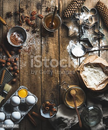 istock Christmas holiday cooking and baking ingredients on wooden background 843574032